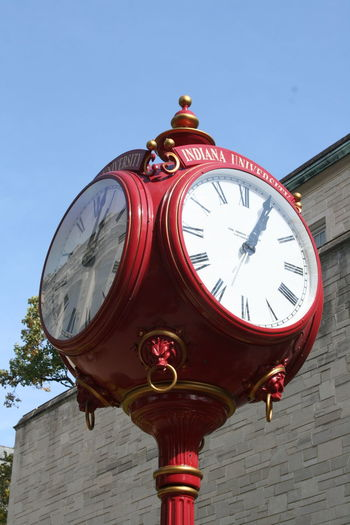 Bloomington, Indiana Blue Building Exterior Circle Clear Sky Clock Clock Face Day Geometric Shape High Section Indiana Indiana University Low Angle View No People Outdoor Outdoors Outside Red Town