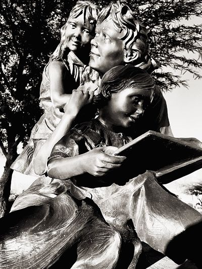 Family reading statue Love Two People Embracing Heterosexual Couple Tree Women Outdoors Men Togetherness Passion People Day Adult Kids Reads Children And Dad Family Time Statue