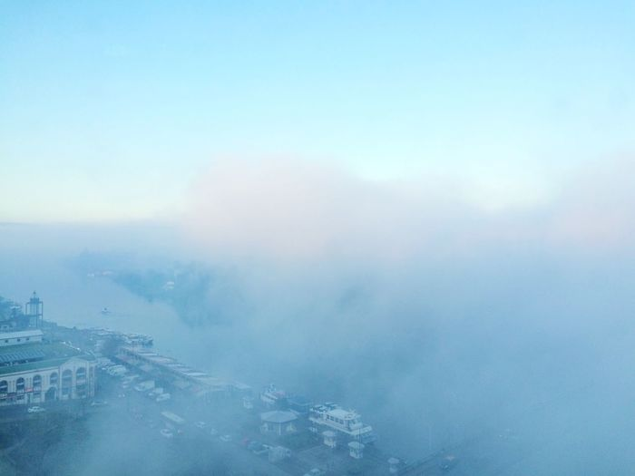 Aerial view of city against sky during winter