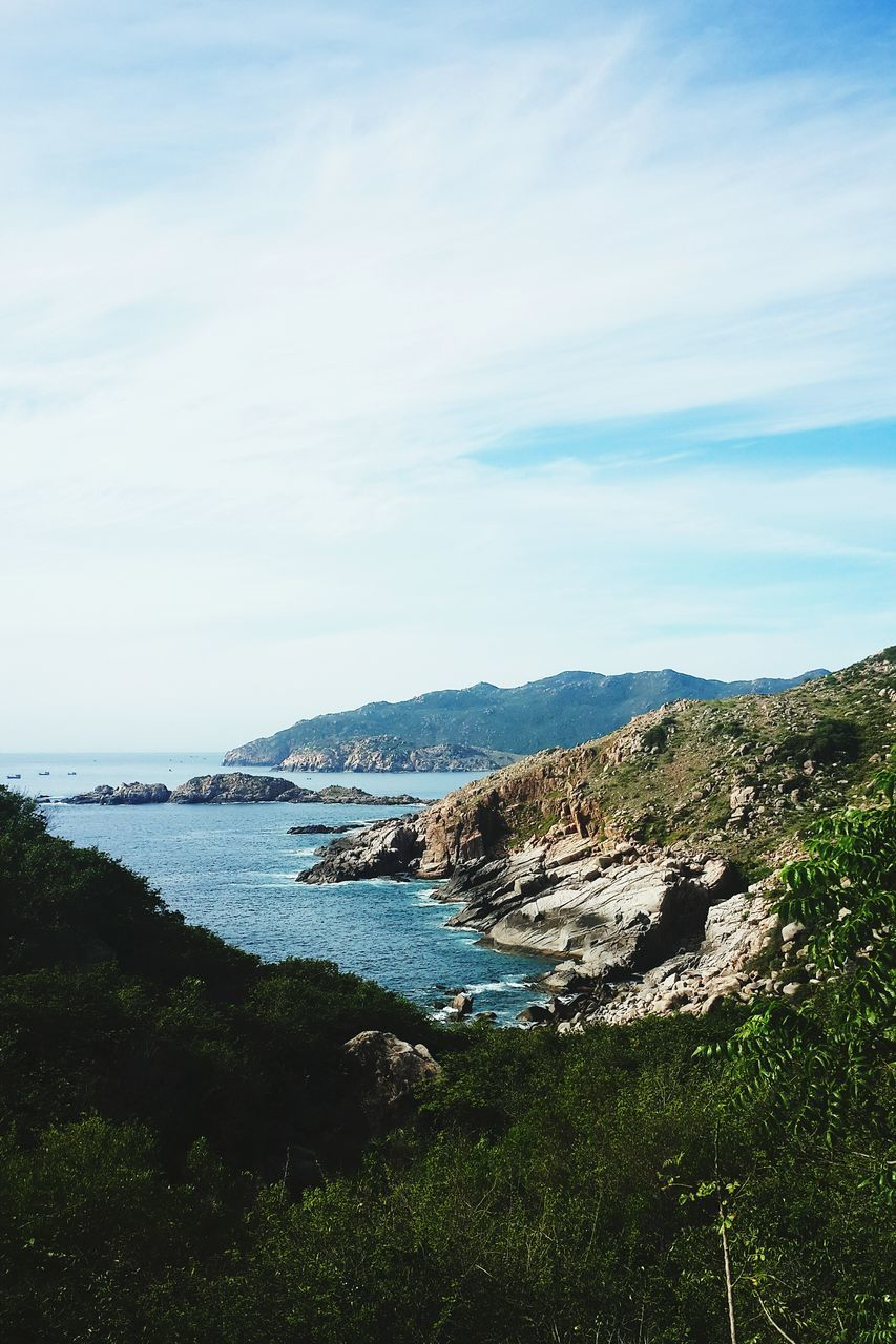 nature, sky, beauty in nature, sea, tranquility, landscape, water, scenics, outdoors, no people, grass, mountain, day, scenery