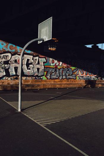 Graffiti on road in city at night
