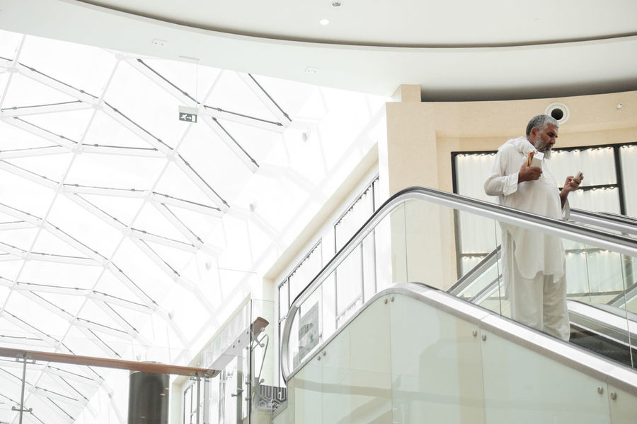 White Mall Architecture Built Structure Day Full Length Indoors  Leisure Activity Lifestyles Low Angle View Man Men Modern Older Man One Person People Railing Real People Staircase Standing Steps And Staircases The Street Photographer - 2017 EyeEm Awards