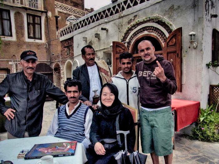Group Of People Adult Looking At Camera Architecture Men Portrait Building Exterior People Togetherness Males  Front View Young Adult Smiling Happiness Standing Young Men Sitting Medium Group Of People