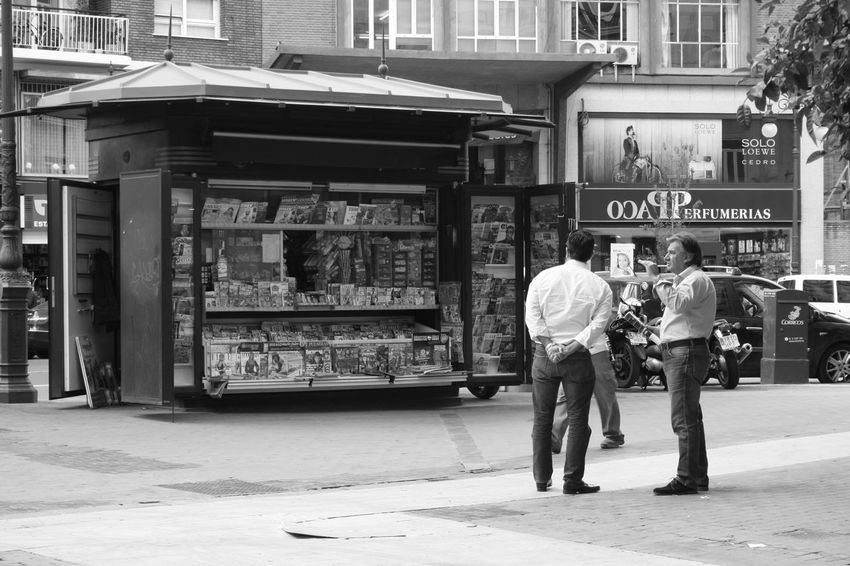 """Everywhere those kiosks are replaced with an automatic wending machines. To see a """"survivor"""" gives a nostalgic feeling. City Life Kiosk Magazines Newspapers Newsstand Nostalgic Place Street Photography Urban Life People Together Monochrome Photography"""