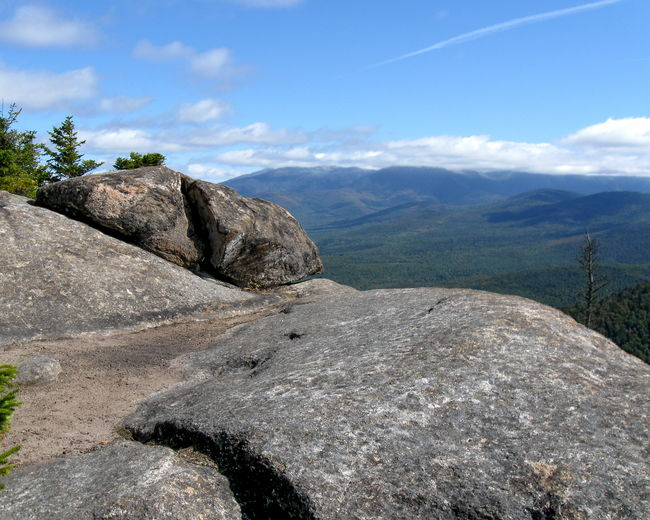 View from the rocky summit of Owl's Head in New Hampshire Beauty In Nature Blue Cloud Cloud - Sky Day Hill Idyllic Landscape Mountain Mountain Range Nature New Hampshire No People Non-urban Scene Outdoors Owl's Head Physical Geography Remote Rock Rock - Object Rock Formation Scenics Sky Tranquil Scene Tranquility