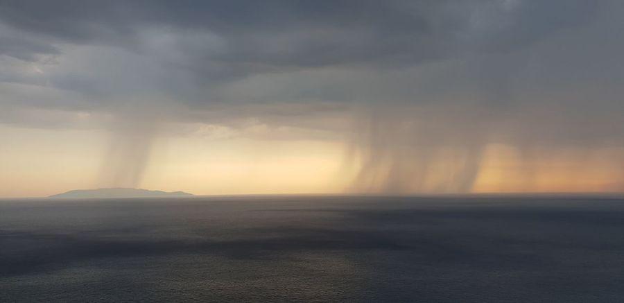 Thunderstorm Sunset Water Fog Power In Nature Natural Phenomenon Storm Cloud Sunlight Awe Dramatic Sky