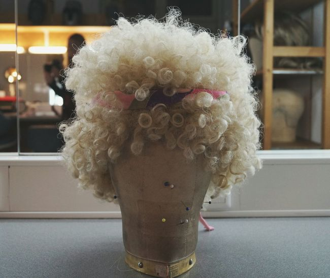 Curly Showcase April Be Someone Else Blonde Curls  Getting Ready Wardrobe Performing Makeup Actors Wigs Stage Theater Hairstyle Hair Need A Haircut Mirror Ribbon Pins People In The Background EyeEm Best Shots Telling Stories Differently EyeEm Best Edits Showing Imperfection Socket Performing Arts