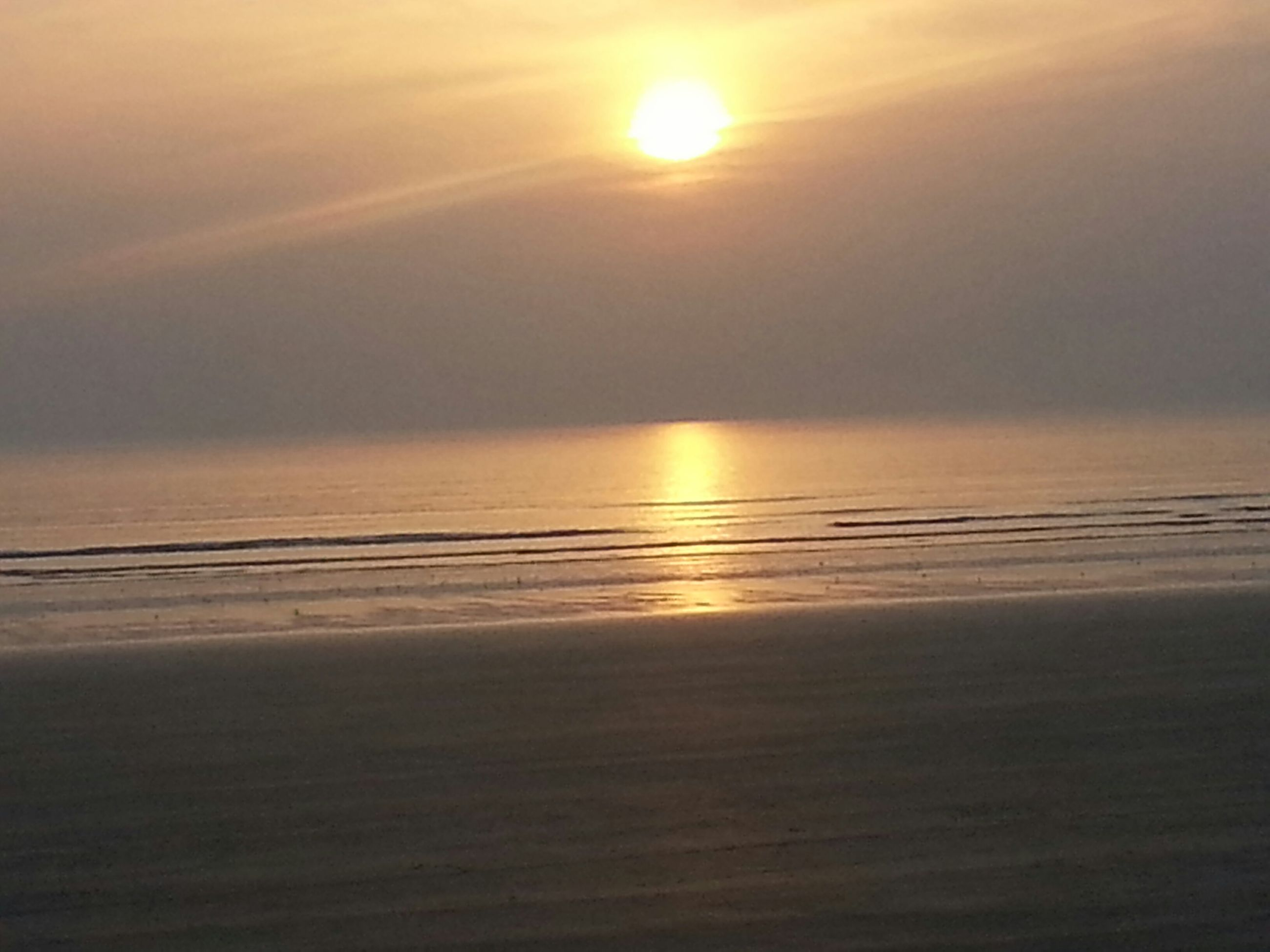 sun, sunset, sea, tranquil scene, scenics, water, horizon over water, tranquility, beauty in nature, reflection, beach, sunlight, idyllic, sky, nature, sunbeam, orange color, shore, lens flare, outdoors