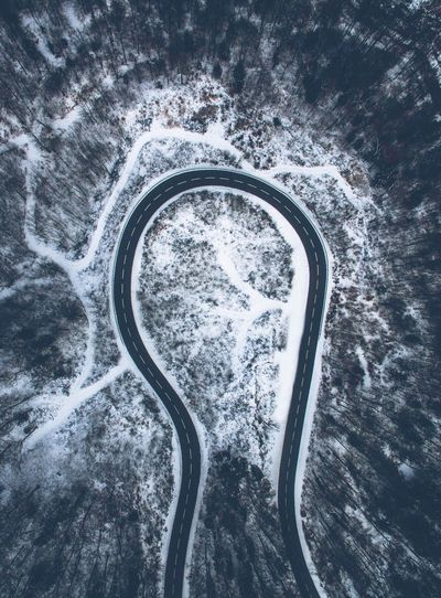 Aerial View Of Curved Road During Winter Season