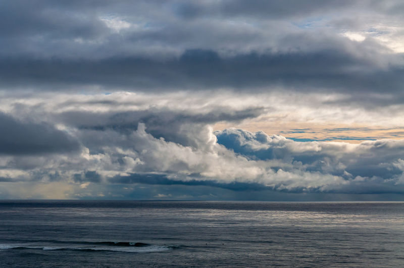 Sunset Cliffs Natural Park and Plant Preserve looking out over a dramatic stormy sky over the ocean. Cloud - Sky Sky Sea Water Scenics - Nature Beauty In Nature Horizon Over Water Horizon Tranquility Tranquil Scene Nature No People Storm Outdoors Day Idyllic Overcast Non-urban Scene Ominous Meteorology
