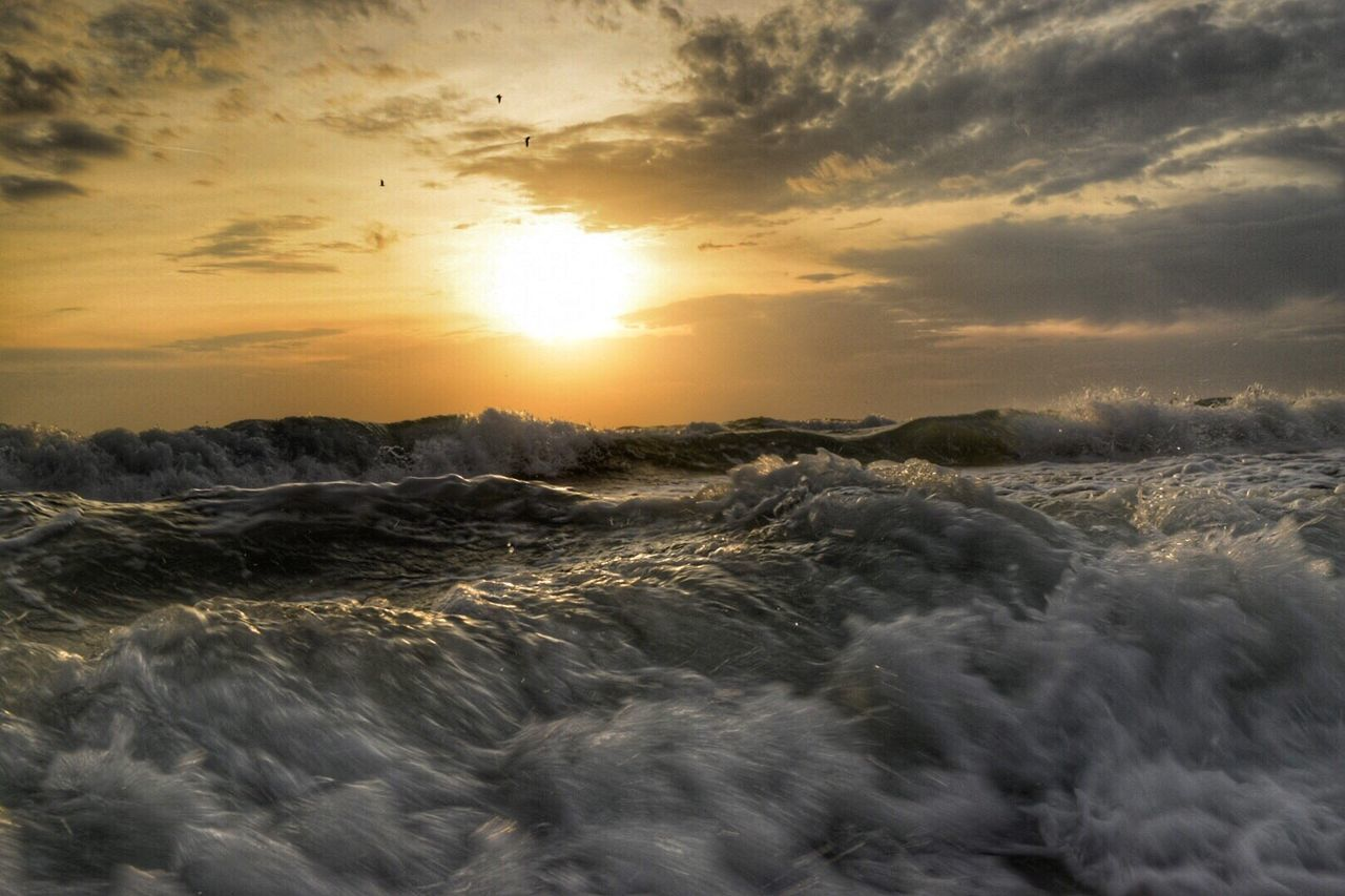 sunset, wave, nature, sky, cloud - sky, beauty in nature, sea, motion, dramatic sky, orange color, no people, scenics, water, sun, power in nature, tranquility, sunlight, outdoors, day