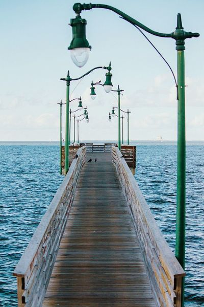 Sea Water Horizon Over Water Outdoors Tranquility Sky Day No People Jensen Beach Florida Pier East Coast Vertical Landscape Birds Nature Lamp Walkway By Water