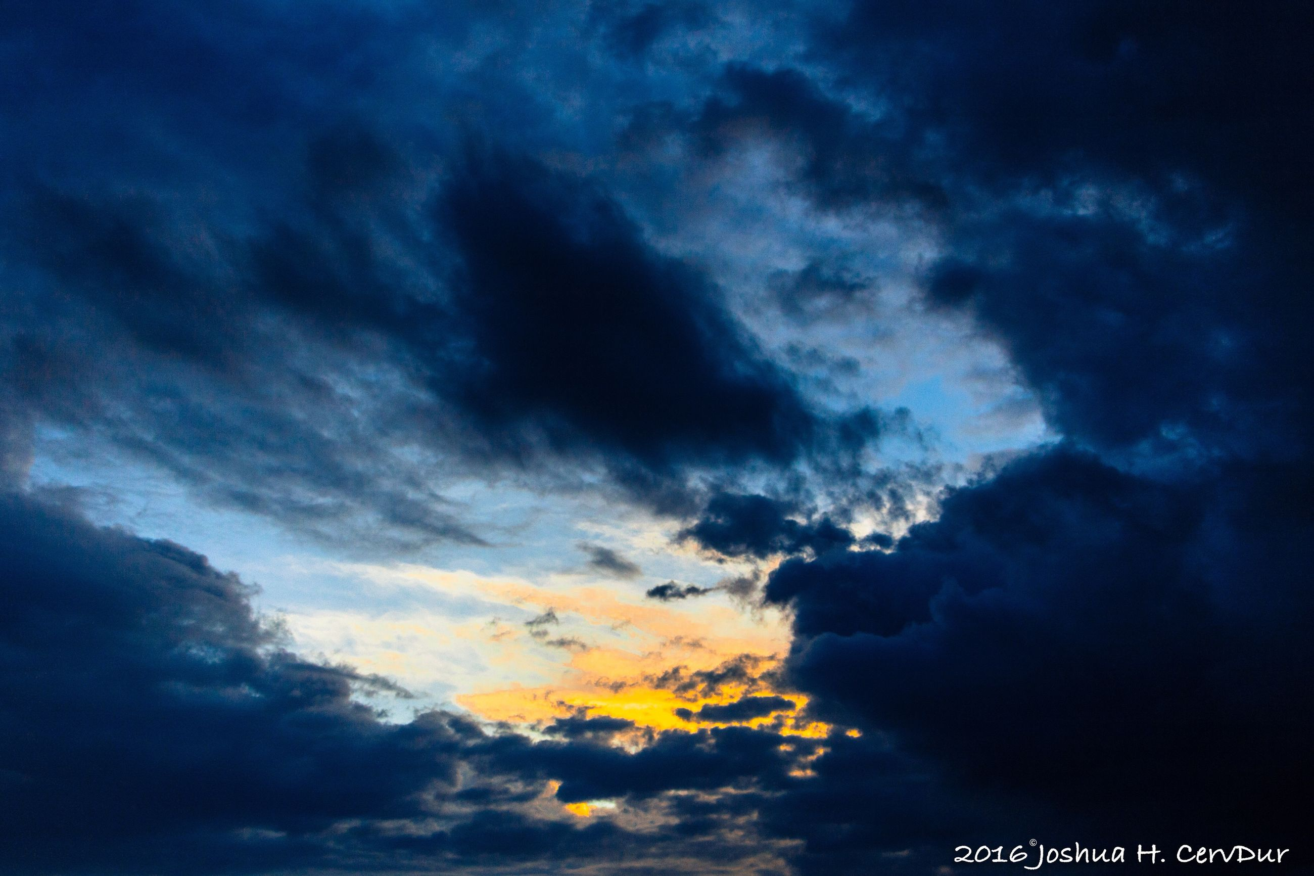 sky, cloud - sky, low angle view, cloudy, beauty in nature, scenics, nature, tranquility, cloudscape, tranquil scene, dramatic sky, weather, cloud, sky only, overcast, idyllic, blue, outdoors, backgrounds, no people, majestic, full frame