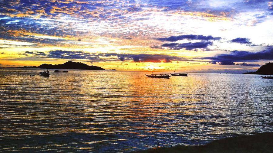 Fotografia Tolitoli Indonesia_photography #SYFfotoshoot Water Nautical Vessel Sea Sunset Beach Rippled Sunlight Waterfront Reflection