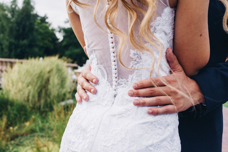 Adult Bride Celebration Couple - Relationship Day Event Focus On Foreground Hand Human Hand Life Events Midsection Newlywed Outdoors People Positive Emotion Real People Standing Togetherness Two People Wedding Wedding Dress White Color Women