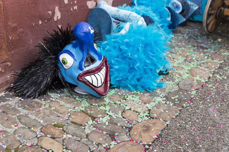 Nadelberg, Basel, Switzerland - March 7, 2017. Funny blue carnival masks laying on the confetti covered street. Basel Carnival Celebration Disguise Event Fun Red Tourist Attraction  Tradition Blue Close-up Colorful Confetti Creative Entertainment Fasnacht Festival Mask - Disguise No People Shrove Tuesday Smiling Street Streetphotography Swiss Switzerland