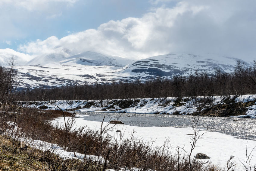 Spring in Abisko River Abisko Beauty In Nature Cold Temperature Day Landscape Mountain Nature No People Outdoors Scenics Sky Snow Snowcapped Mountain Sweden Tranquil Scene Tranquility Winter