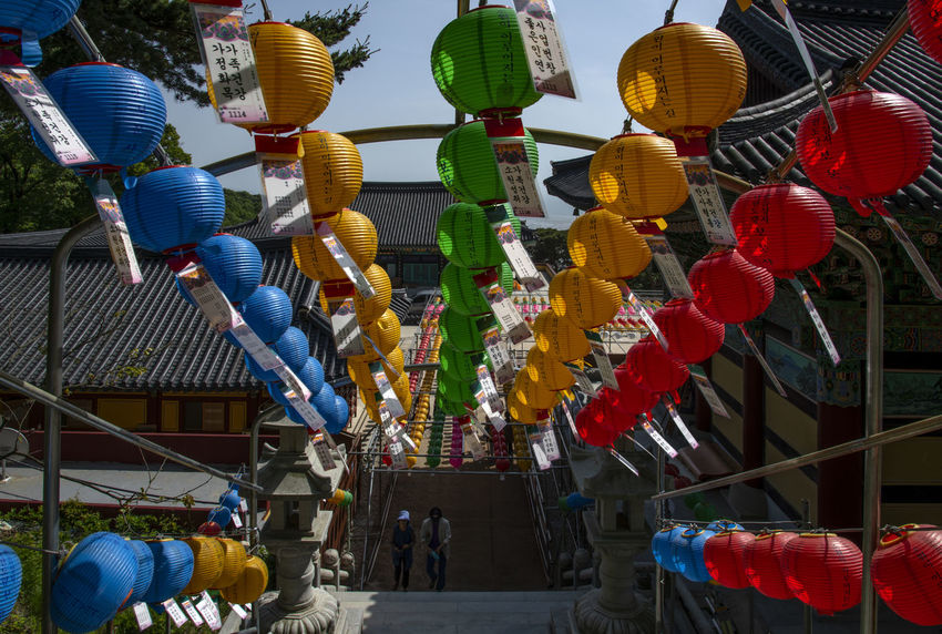 view at Bomunsa, a famous Buddhism temple in Seokmodo, Kimpo, Gyeonggido, South Korea Architecture Bomunsa Buddhism Temple Seokmodo South Korea Architecture Art And Craft Belief Buddhism Building Built Structure Day Decoration Festival Hanging In A Row Lantern Large Group Of Objects Lighting Equipment Low Angle View Multi Colored Outdoors Real People Religion Religious  Representation Temple