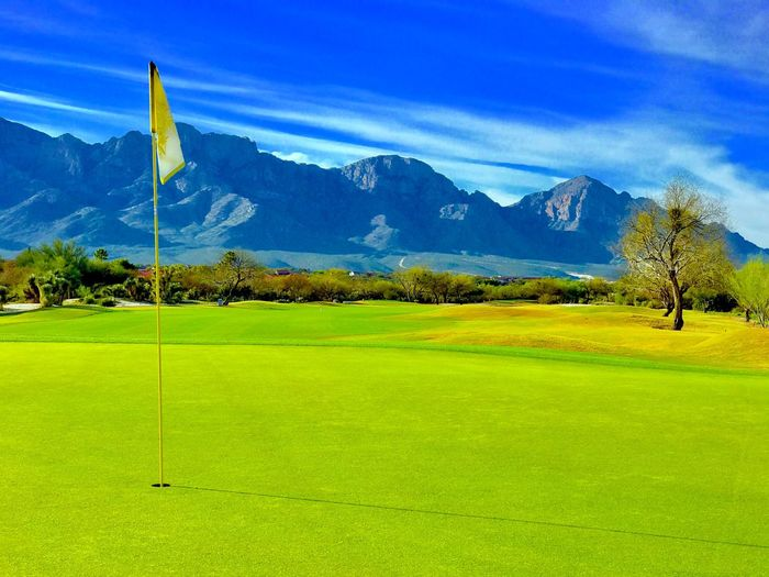 Flag Sky Blue Scenics Golf Tranquil Scene Beauty In Nature Golf Course No People Mountain Nature Grass Landscape Tranquility Golf Flag Green Color Green - Golf Course Outdoors Day Tree Check This Out EyeEmNewHere @ceedubslens