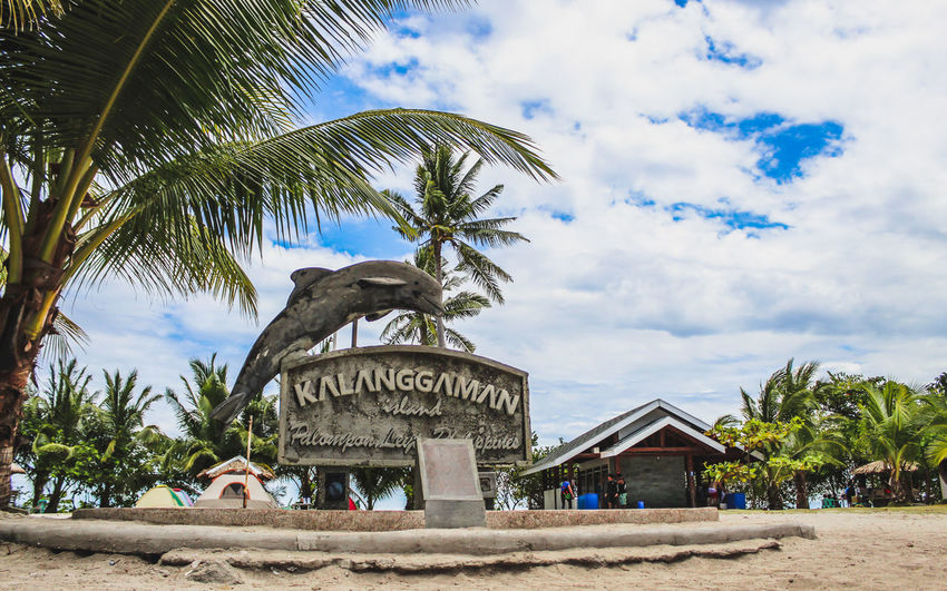 Kalanggaman Island Philippines Architecture Beach Building Building Exterior Built Structure Cloud - Sky Day Growth Kalanggamanisland Land Leyte, Philippines Low Angle View Nature No People Palm Leaf Palm Tree Plant Sky Text Travel Destinations Tree Tropical Climate
