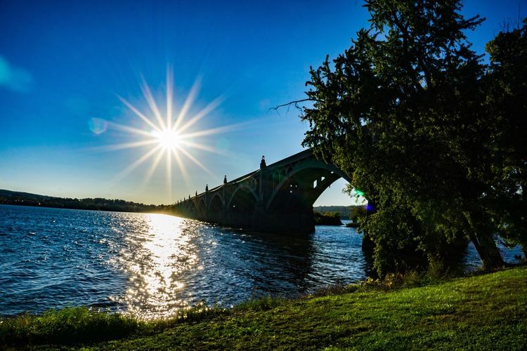 Water Tree River Nature Outdoors Built Structure Sky Architecture Tranquility Scenics Tranquil Scene Beauty In Nature No People Sunbeam Sun Day Bridge - Man Made Structure