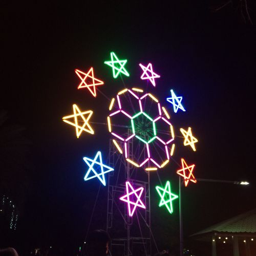 Night Illuminated Star Shape Sign Arts Culture And Entertainment Celebration Lighting Equipment No People Decoration Star - Space Light Motion Holiday Nature Human Representation Blue Glowing Light - Natural Phenomenon Creativity Outdoors