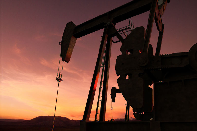 Low Angle Silhouette Oil Pump Against Clear Sky During Sunset