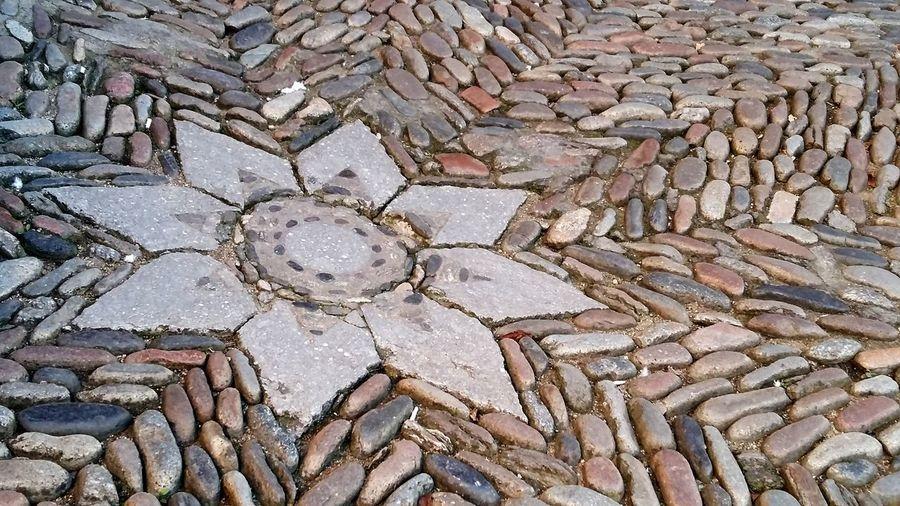 Estrellas en el suelo Girona Empedrado Suelo Suelo Empedrado Full Frame Backgrounds Day Outdoors No People Textured