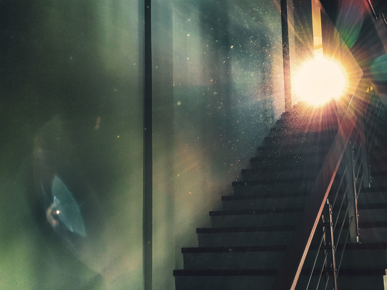 staircase, steps and staircases, architecture, railing, indoors, built structure, lens flare, real people, low angle view, glass - material, window, one person, illuminated, nature, sunlight, sunbeam, reflection, direction