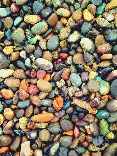 Full Frame Shot Of Colorful Pebbles On Beach