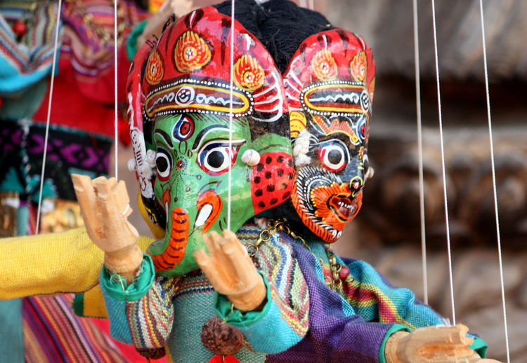 Close-Up Of Colorful Puppets Hanging