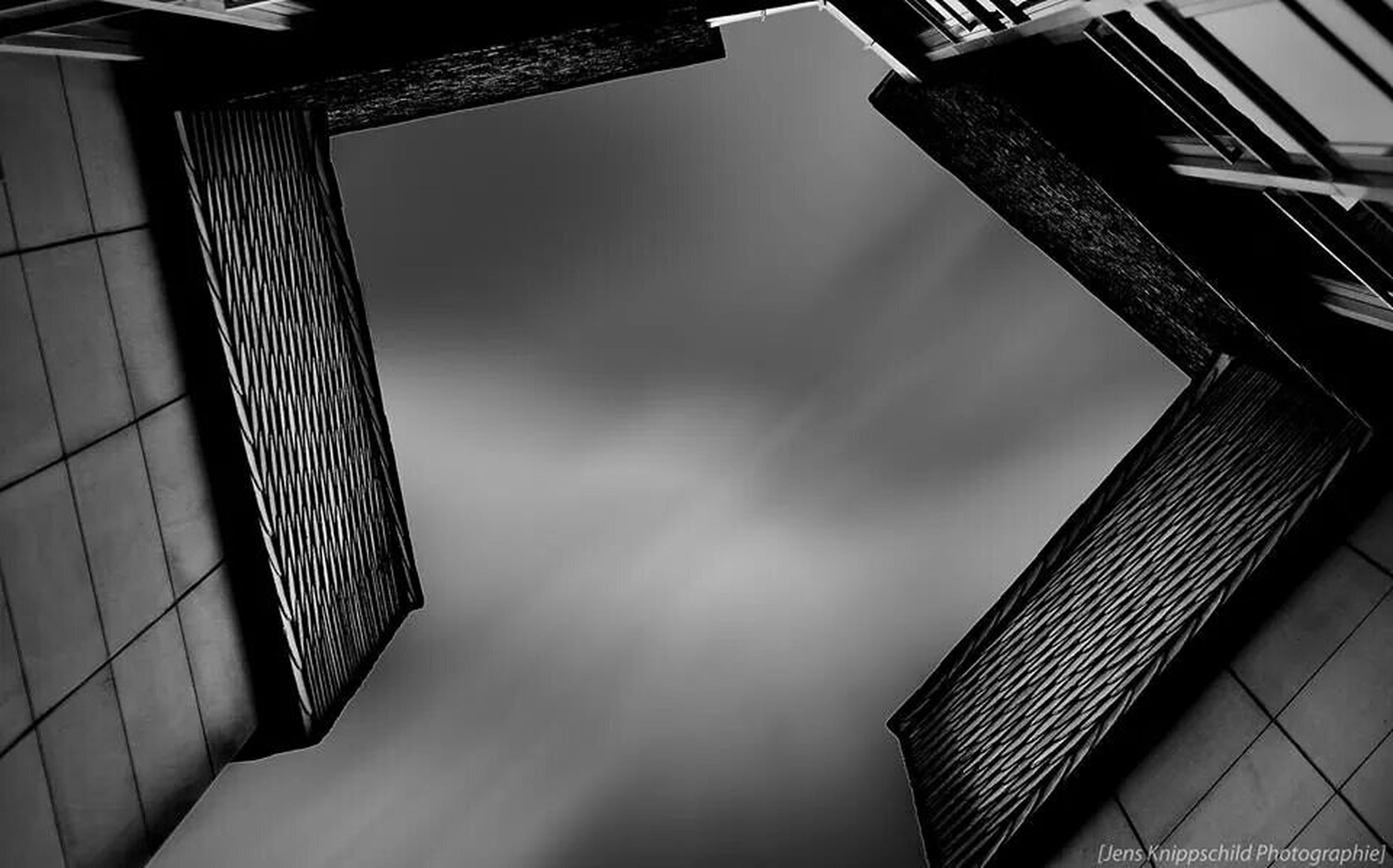 architecture, built structure, building exterior, low angle view, sky, building, directly below, city, modern, residential building, residential structure, office building, window, no people, day, outdoors, tower, tall - high, cloud - sky, house