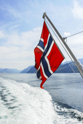 The waterways in Norway Beauty In Nature Cloud - Sky Day Flag Nature No People Outdoors Patriotism Red Sky