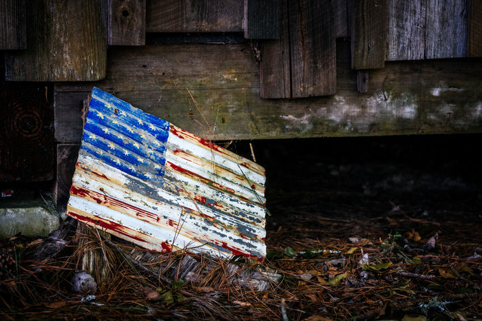 Down but not Out Abandoned American Flag Bad Condition Broken Close-up Damaged Deterioration Dirty Empty Flag Messy No People Old Outdoors Run-down USA Weathered Wood Wood - Material Wooden
