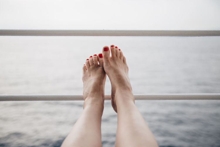 Water Low Section barefoot Human Body Part Body Part Human Leg Human Foot Sea Adult Relaxation Nature One Person Leisure Activity Outdoors Rest And Relaxation Cruise Ship Ocean Balcony Travel Traveling Holiday Vacation Vacationtime Legs Nail Polish