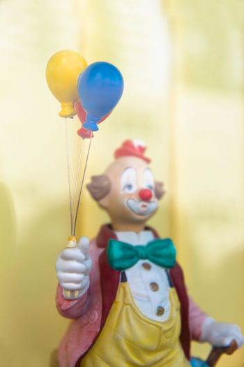 Yellow Balloon Multi Colored Focus On Foreground Representation Childhood Art And Craft Human Representation People Blue Creativity Toy Celebration Day Indoors  Holding Helium Balloon Funny Clown Blurred Background Cheer Up Cheer Clown Costume