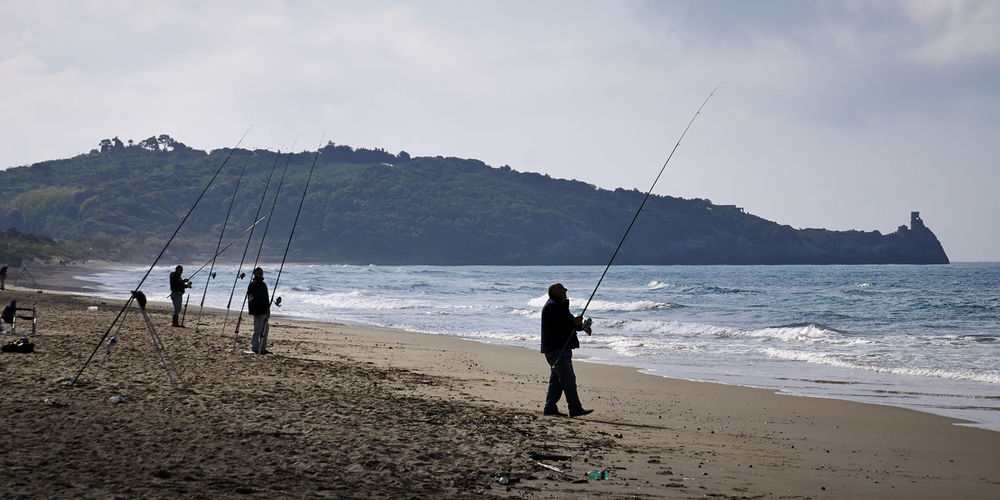 People fishing at beach