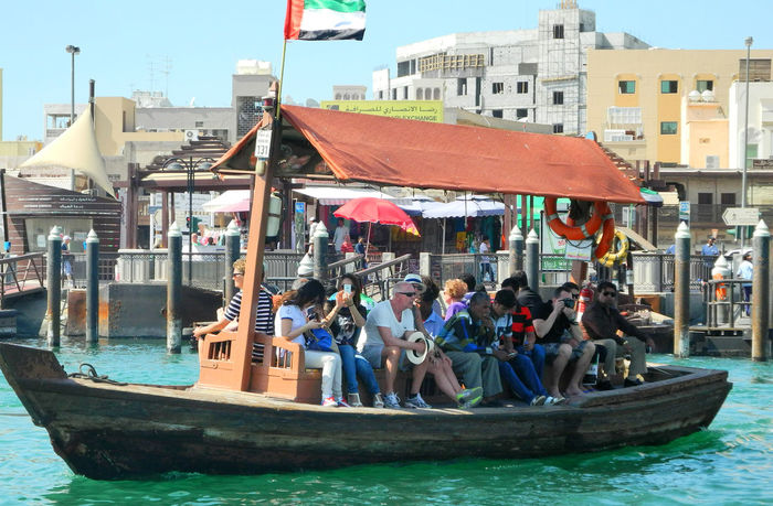 Tourist boat - Duabi Creek, UAE Adult Architecture Building Exterior Built Structure Day Dubai Creek Large Group Of People Leisure Activity Lifestyles Men Nature Nautical Vessel Outdoors People Real People Sitting Tourist Boat Tourists On Tour Transportation Water Waterfront Women