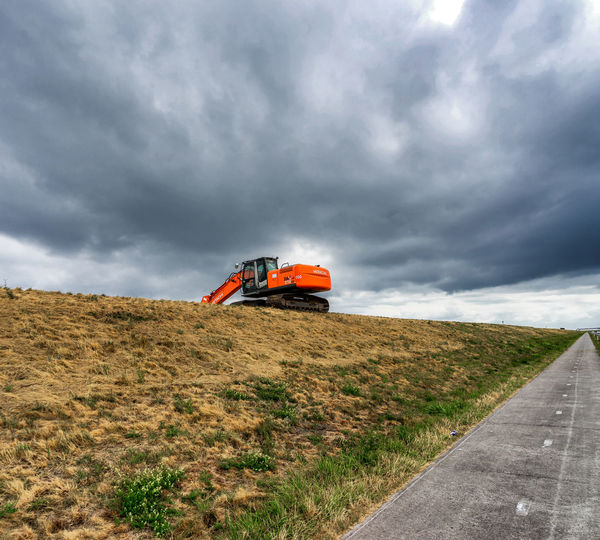 Construction work at the Markerwaarddijk Construction Site Cloud - Sky Day Dike Top Dikeroad Direction Environment Field Grass Land Landscape Mode Of Transportation Nature No People Non-urban Scene Outdoors Plant Road Scenics - Nature Sky Tranquil Scene Transportation