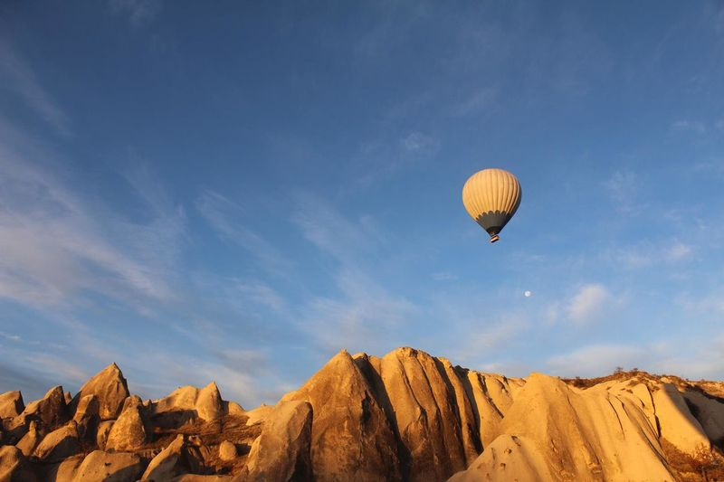 Balloon ride in Cappadocia's autumn. Adventure Beauty In Nature Blue Cappadocia Carefree Day Exploration Extreme Sports Extreme Terrain Flying Getting Away From It All Hot Air Balloon Low Angle View Mid-air Mountain Nature Outdoor Pursuit Outdoors Physical Geography Rock Formation Scenics Sky Tranquil Scene Tranquility Transportation