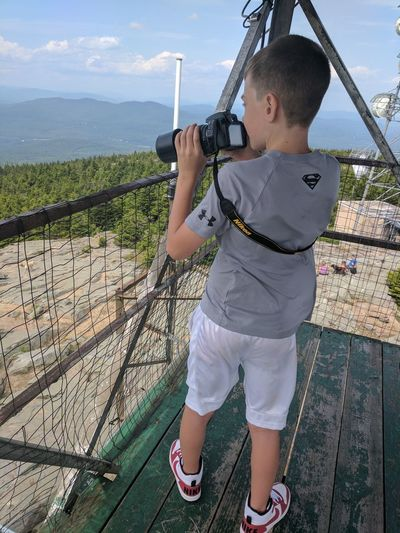 My son with my camera taking pictutes from the mountian top today. His passion for photography grows by the day and i love it. Standing One Person People Sea Outdoors Men One Man Only Day Only Men Adult One Young Man Only Young Adult Vacations Child Sky Water No Filter Needed EyeEm Selects Breathing Space Investing In Quality Of Life Connected By Travel This Is Family