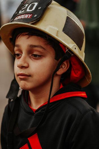 Close-up of boy wearing hardhat