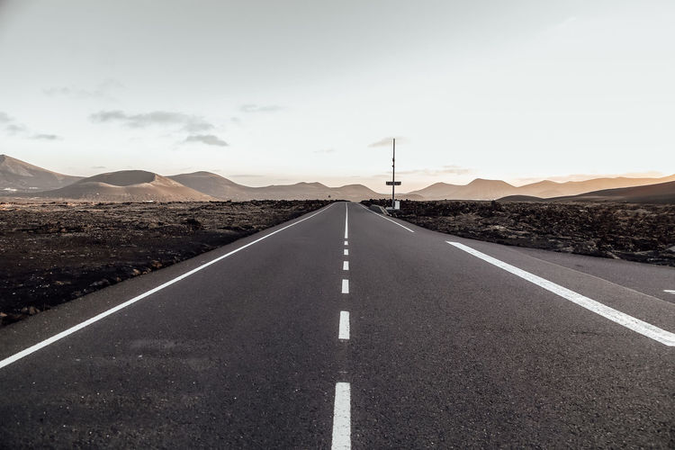 Diminishing prospective of the road in the desert, lanzarote island