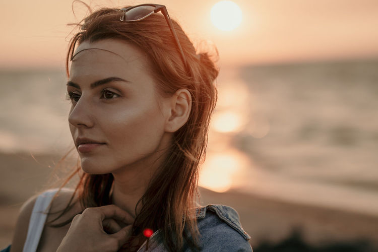 Contemplation Hair Sunset_collection Beautiful Woman Focus On Foreground Headshot Highlight Highlights Jacket Lifestyles Ocean One Person Outdoors Portrait Real People Sea Sky Sunglasses Sunset Water Women Young Adult Young Women