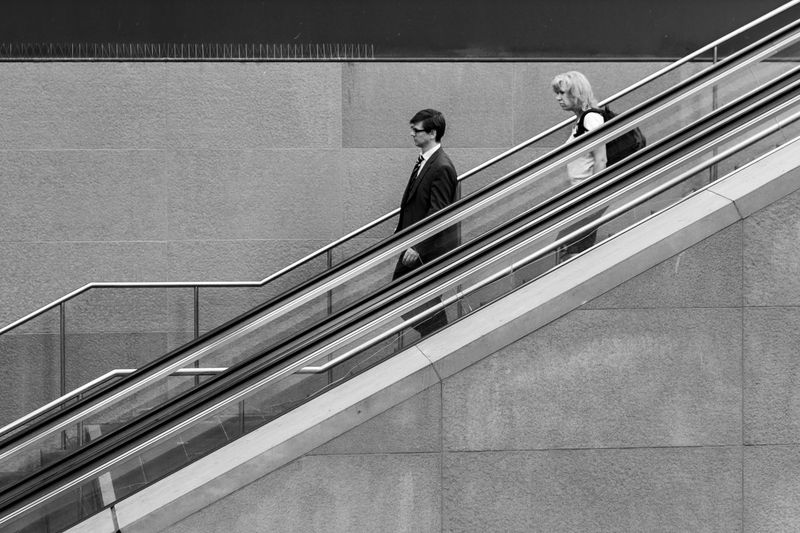 People looking at camera on staircase