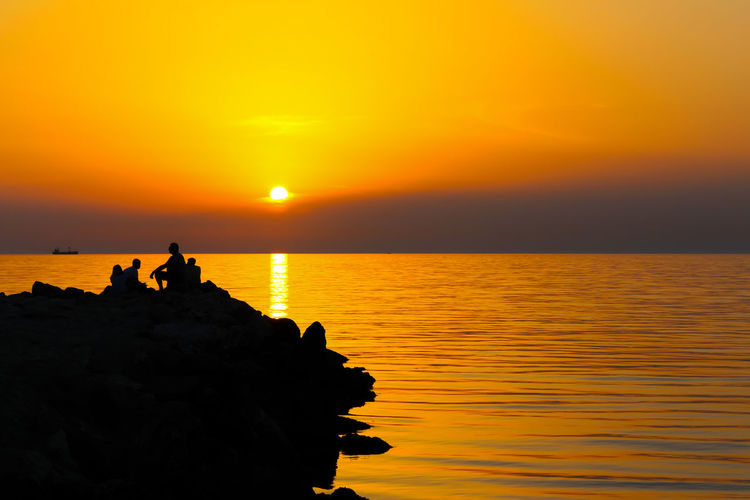Silhouette and sunset Beauty In Nature Horizon Over Water Nature Orange Color Outdoors Rock - Object Scenics Sea Silhouette Silhouette Photography Sky Sun Sunset Tranquil Scene Water first eyeem photo