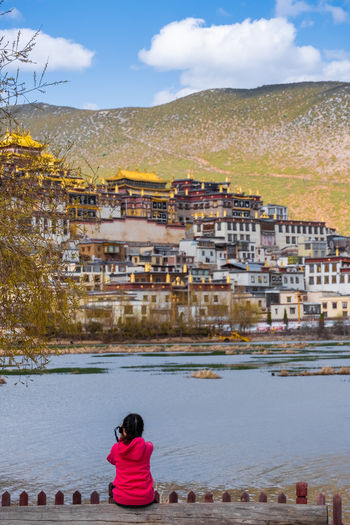 Architecture Built Structure Water Building Exterior Sky Nature Real People City Day Lifestyles Rear View Building Leisure Activity People Residential District Town Cloud - Sky Women Outdoors Cityscape TOWNSCAPE Looking At View Temple Shangrila Shangri-La Yunnan China Tibet Religion Mountain