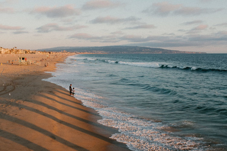 Adult Beach Beauty In Nature Cloud - Sky Day Horizon Over Water Large Group Of People Losangeles Mountain Nature Outdoors People Reflection Sand Scenics Sea Sky Sunset Vacations Water Wave