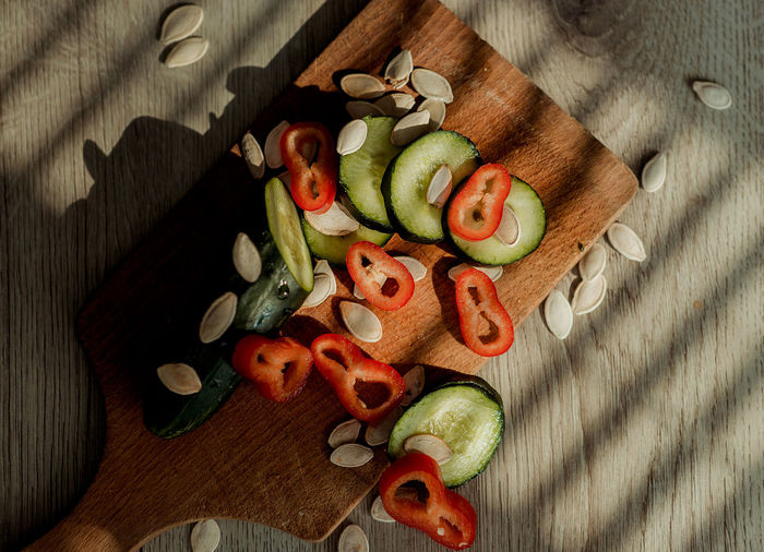 Cucumber Pepper Red Pepper Seeds Pumpkin Seeds Wood Wooden Texture Fruits Fruit Vegetable Vegetables Veggies Orange Oranges Healthy Eating Healthy Fitness Lifestyles Lifestyle Water Studio Shot Macro Macro Photography Kitchen Water Drops