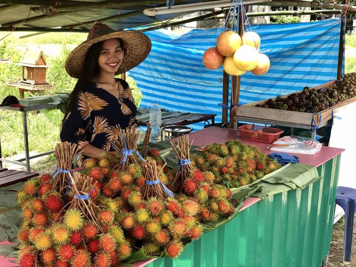 Woman standing by fruits at market